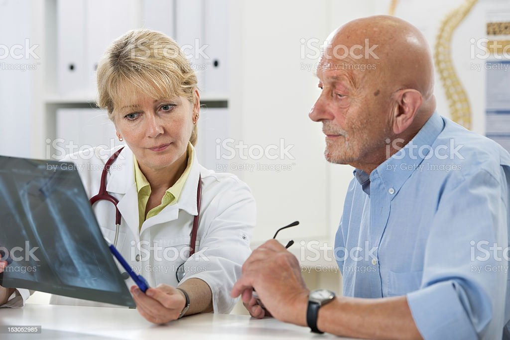 Medical exam with a patient and doctor stock photo