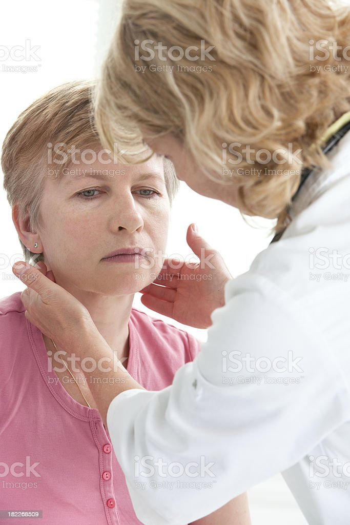Medical exam with elderly woman and doctor stock photo