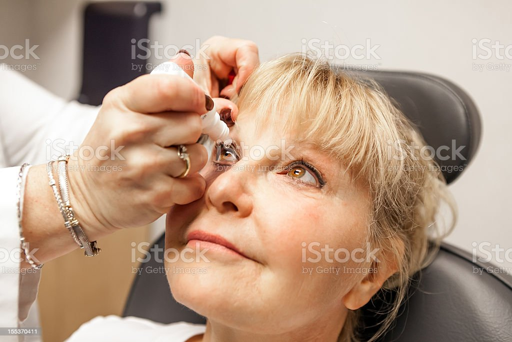 Medical: Eye Exam with drops stock photo