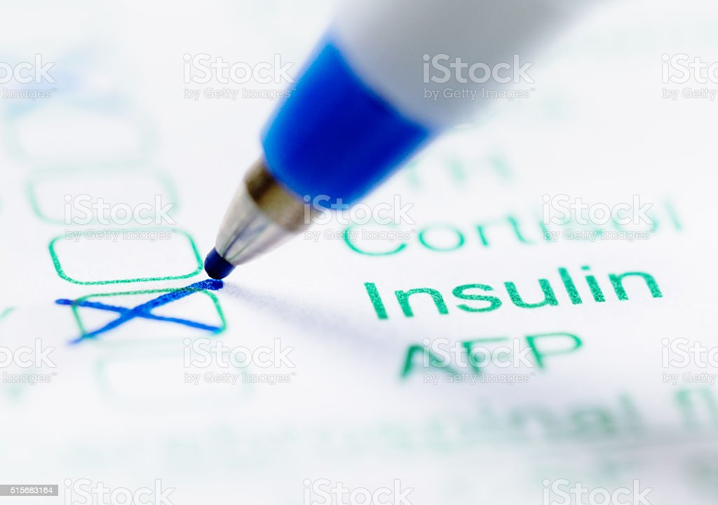 Medical form ordering tests for insulin levels stock photo