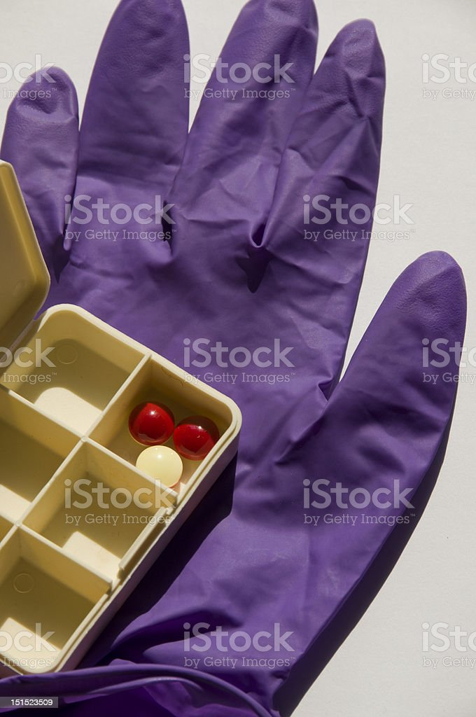 Medical gloves and pill box stock photo