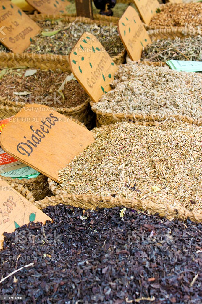 Medical herbs for sale on a market stock photo