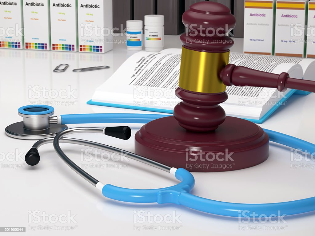 Medical Malpractice, Stethoscope and gavel stock photo