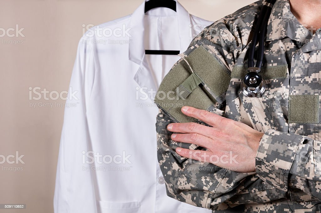 Medical military doctor with white consultation coat in backgrou stock photo