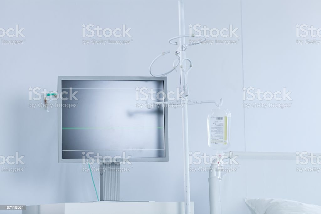 Medical monitor and bed stock photo