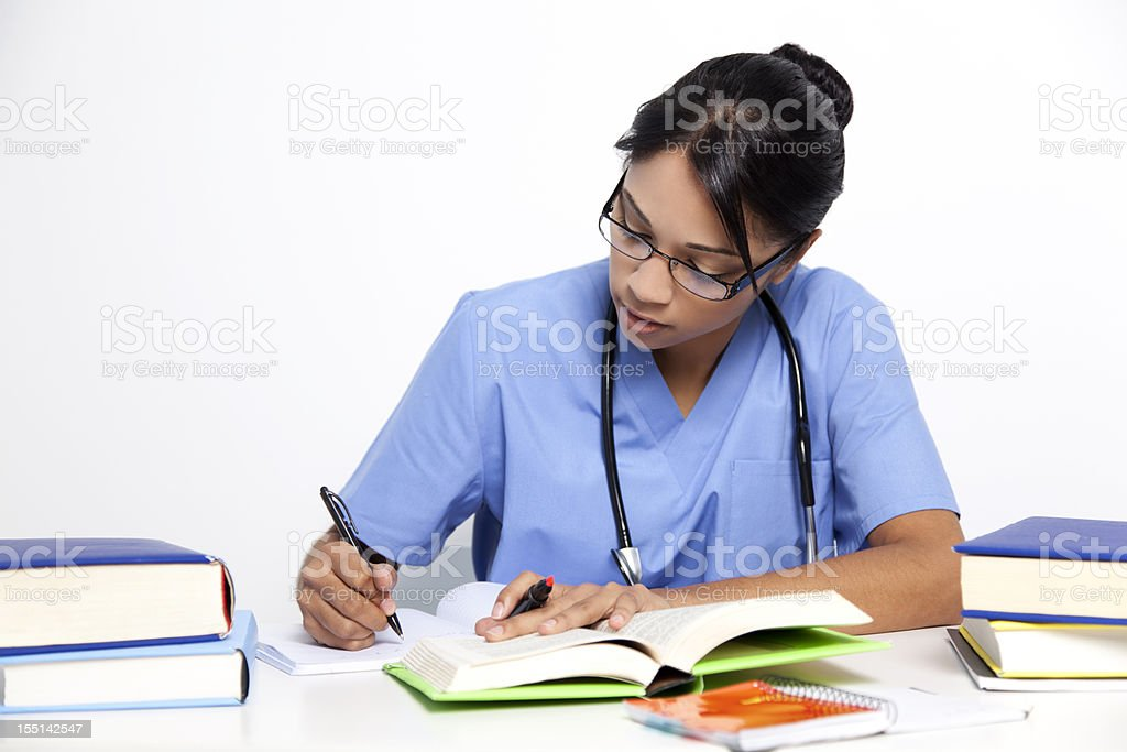 Medical nurse studying for her exams royalty-free stock photo