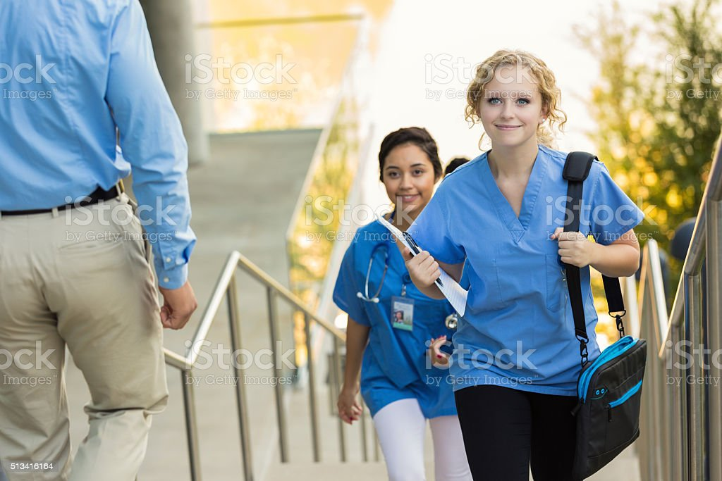 Medical or nursing school student walking to class stock photo