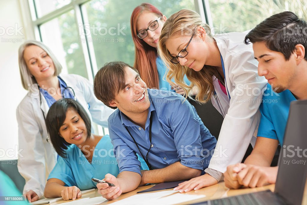 Medical or nursing students working together on patient case stock photo