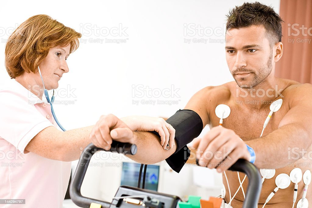 Medical personnel performing EKG on a young male royalty-free stock photo