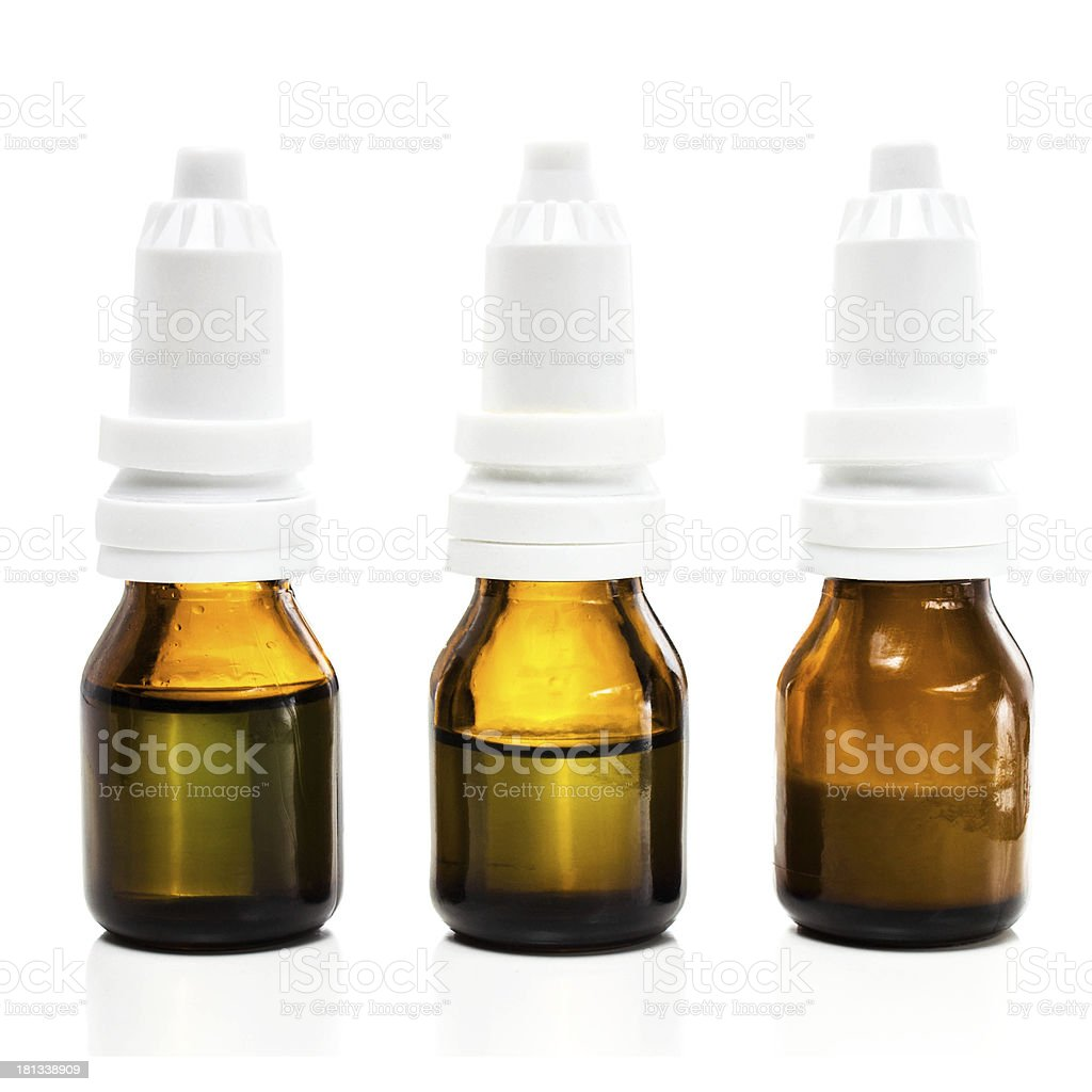 Medical pill bottles with naturopathic medicine liquid, isolated royalty-free stock photo