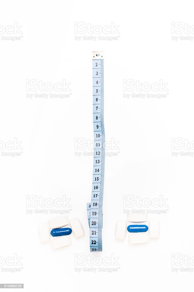 Medical pills and centimeter, for weight loss or increase penis stock photo