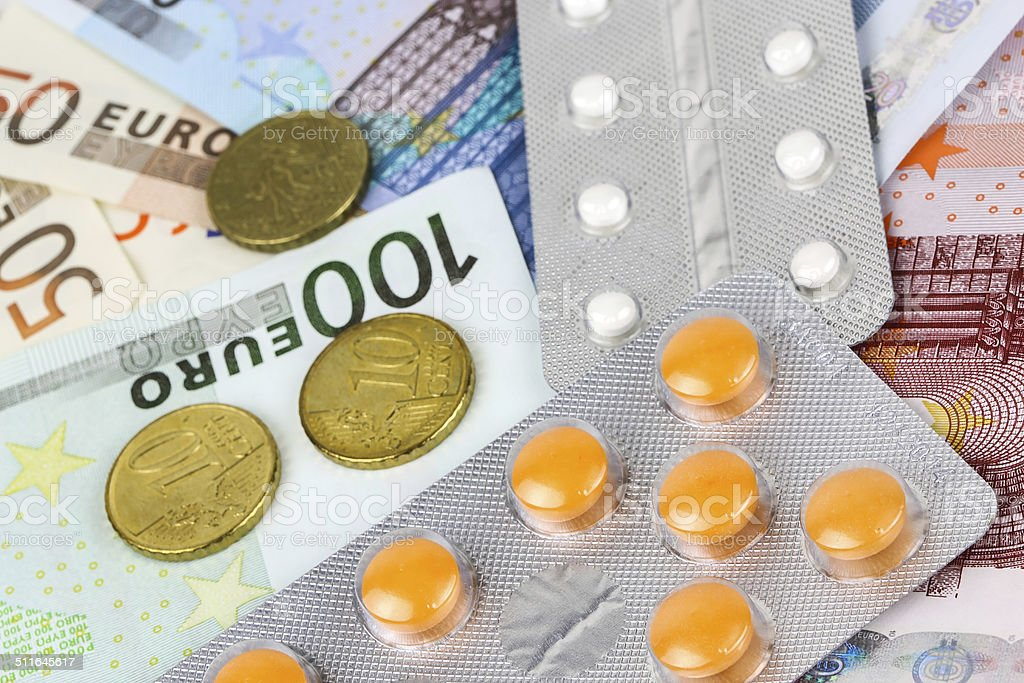 medical pills and tablets in euro bank notes money royalty-free stock photo