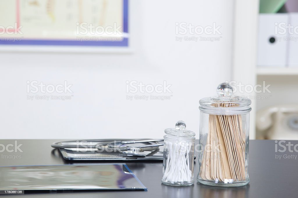 Medical practice office desk with glass jars and stethoscope stock photo
