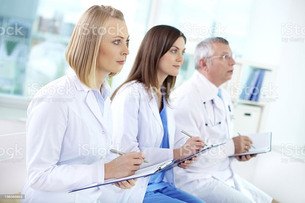 Medical practitioner listening tentatively for a lecture royalty-free stock photo