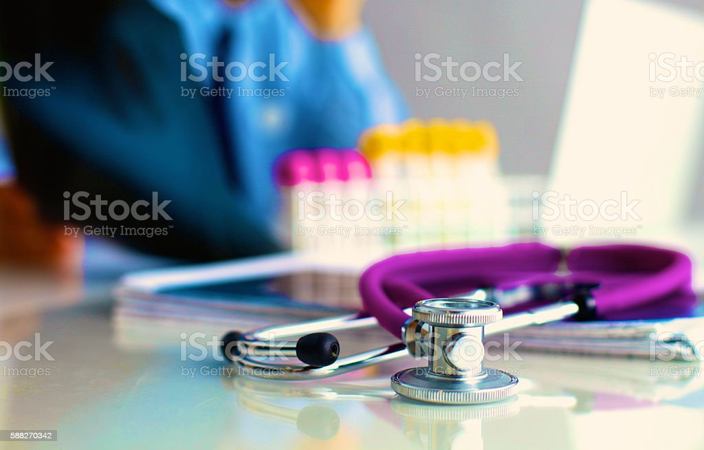 Medical preparations stethoscope doctor sitting at the table stock photo