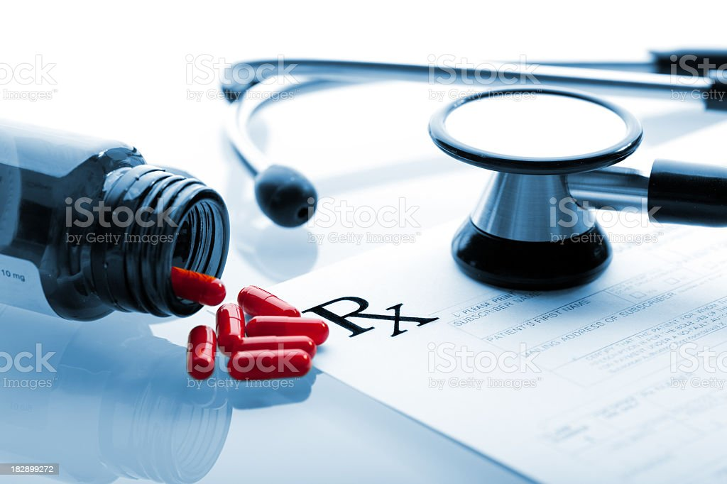 Medical prescription form with RX sign and stethoscope stock photo