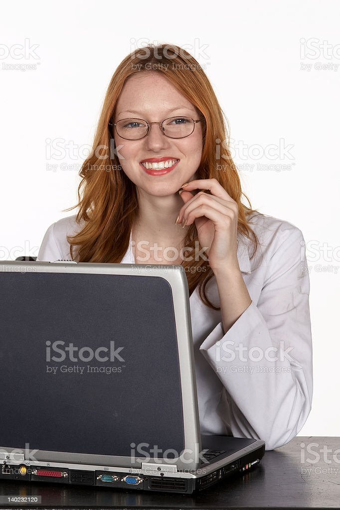 Medical Professional in Lab Coat at Laptop Computer royalty-free stock photo