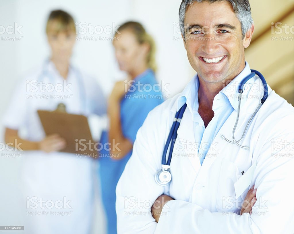 Medical professional standing with arms folded royalty-free stock photo