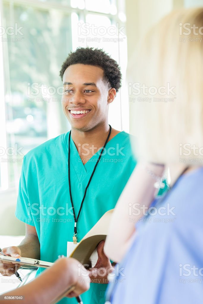 Medical professionals prepare for meeting stock photo