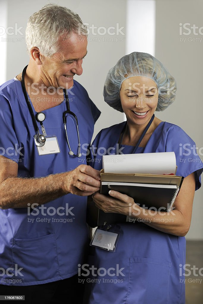 Medical professionals reviewing a chart royalty-free stock photo