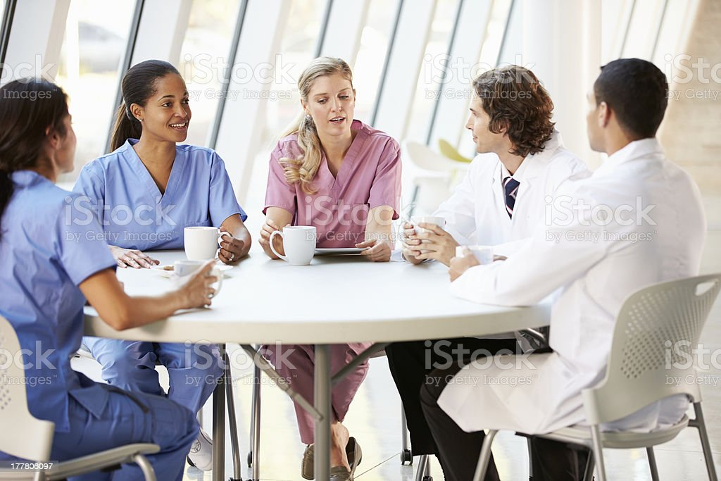 Medical professionals talking in a cafeteria stock photo