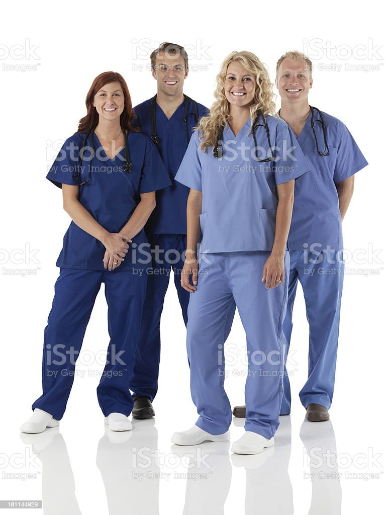 Medical professionals team posing against white royalty-free stock photo