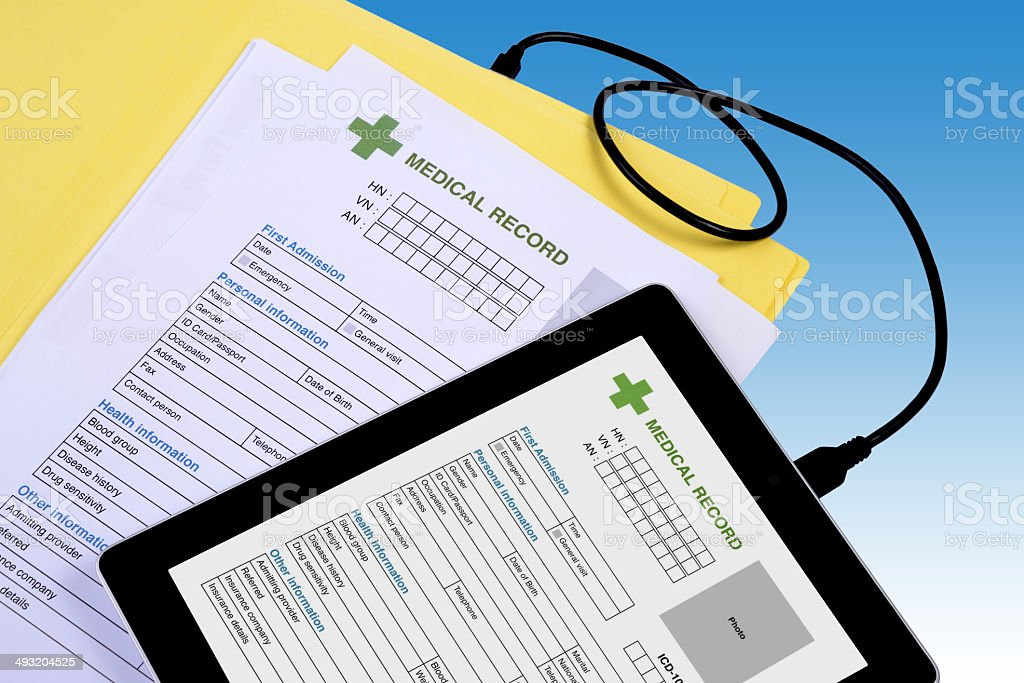 Medical record transfer to tablet. stock photo