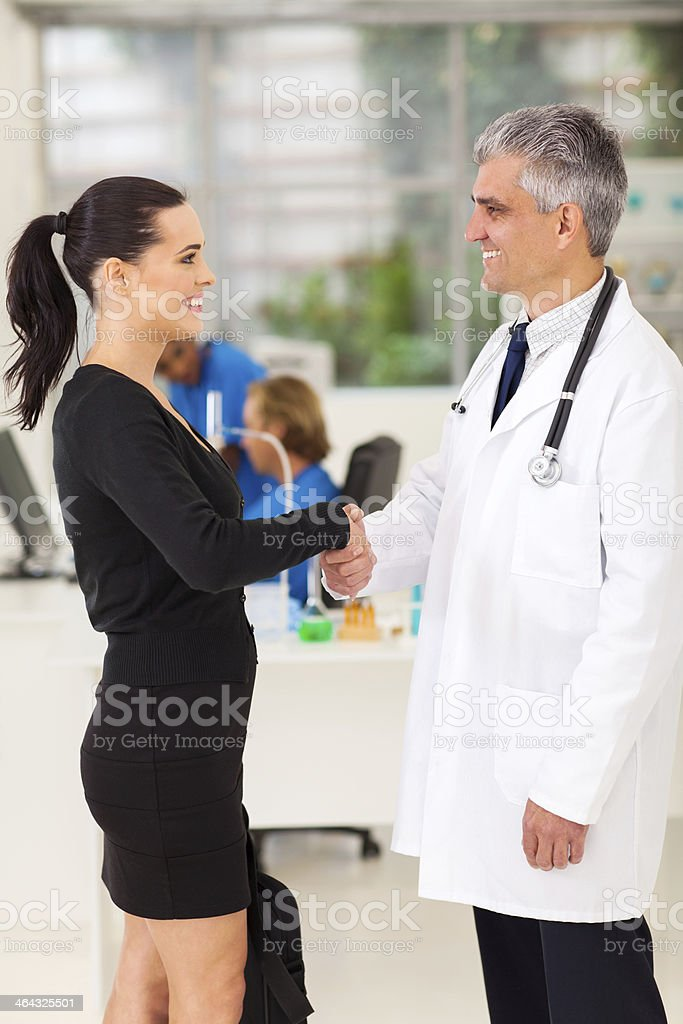 medical rep handshaking with senior doctor stock photo