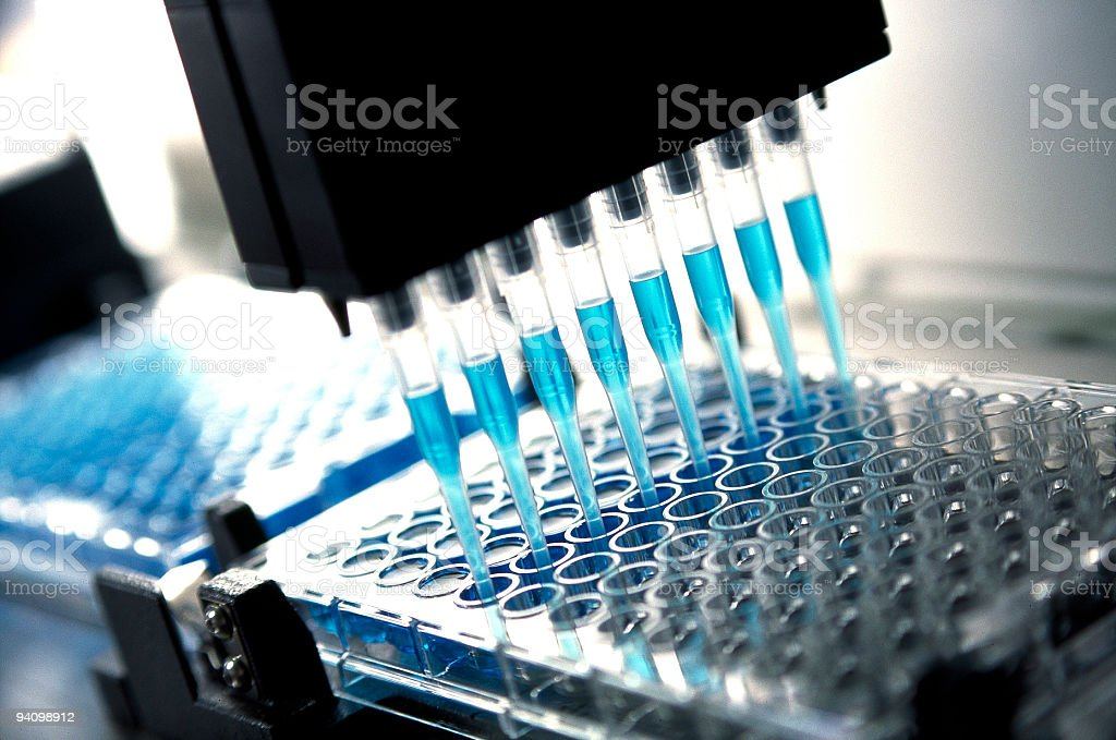 medical  research and pharmaceutical research : robotic pipette device stock photo