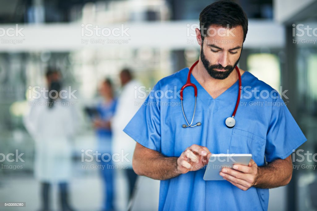 Medical research for a doctor on the move stock photo