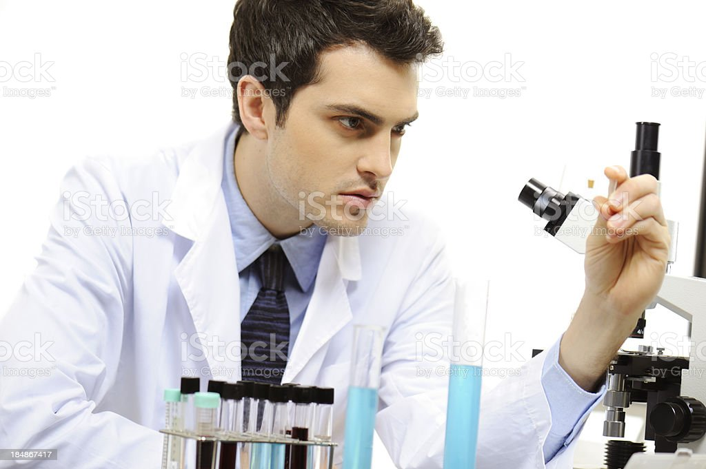 Medical research staff looking at slide glass royalty-free stock photo