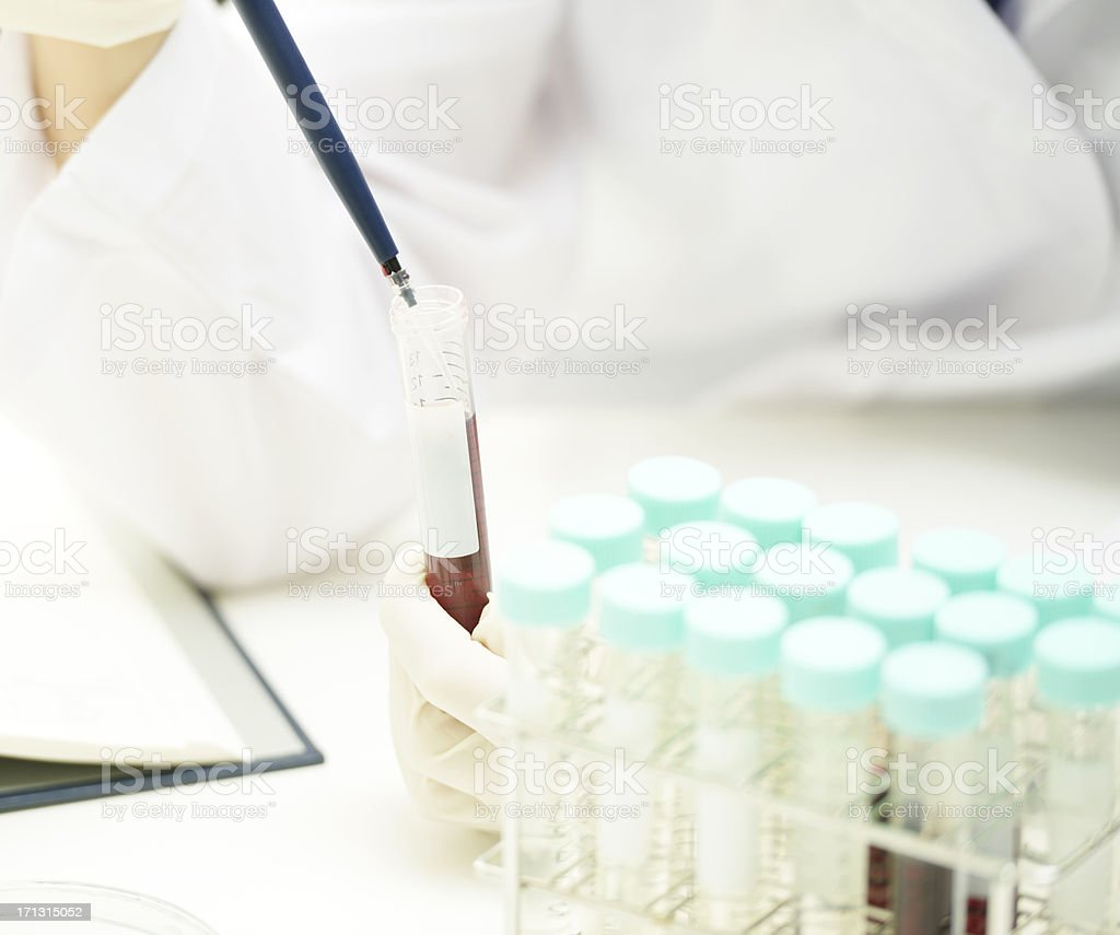Medical researcher examining sample royalty-free stock photo