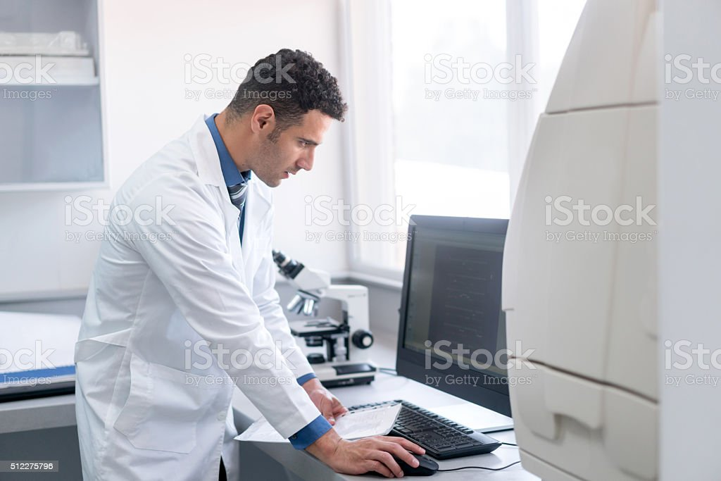 Medical researcher working at the hospital stock photo