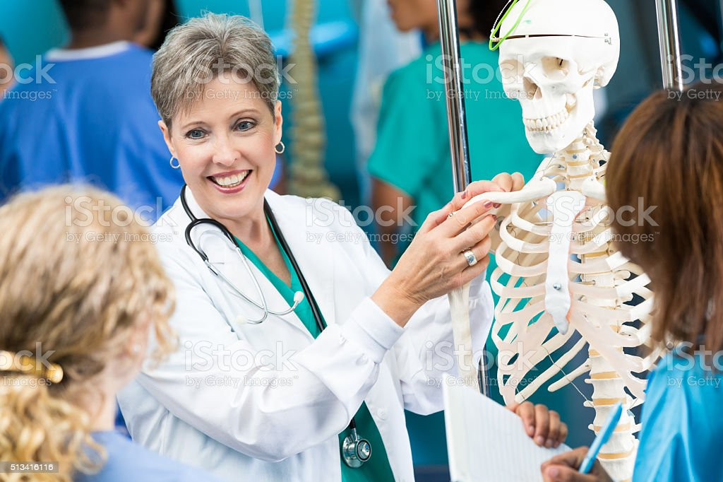 Medical school professor teaches anatomy class stock photo