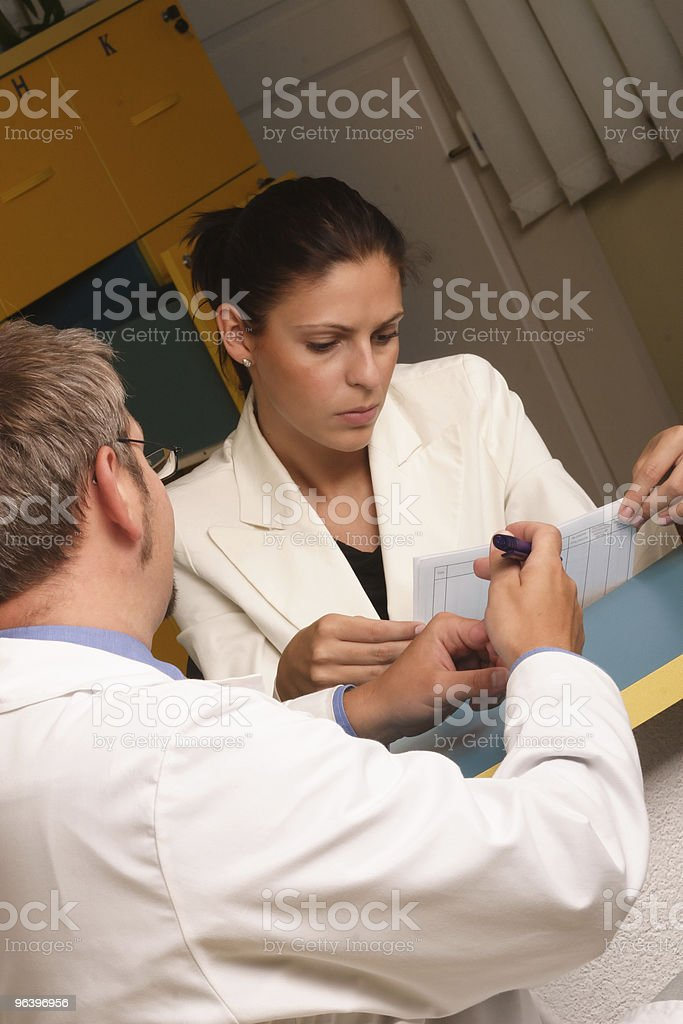 Medical secretary and doctor working together royalty-free stock photo