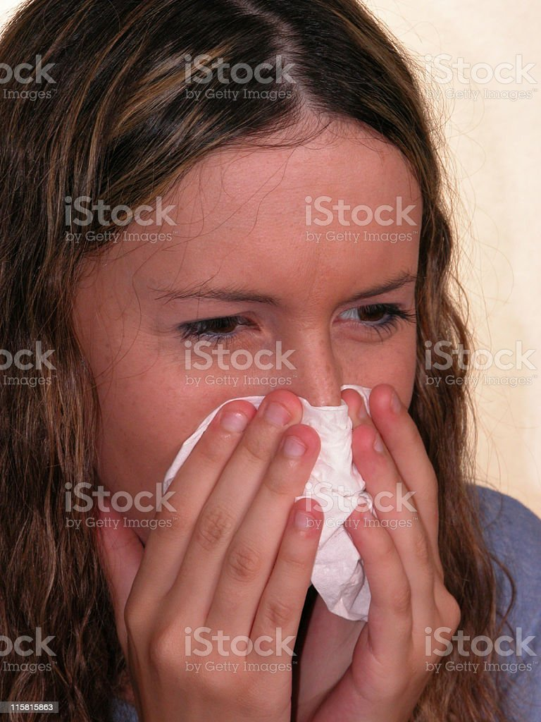Medical:  Sick Girl Blows Her Nose royalty-free stock photo