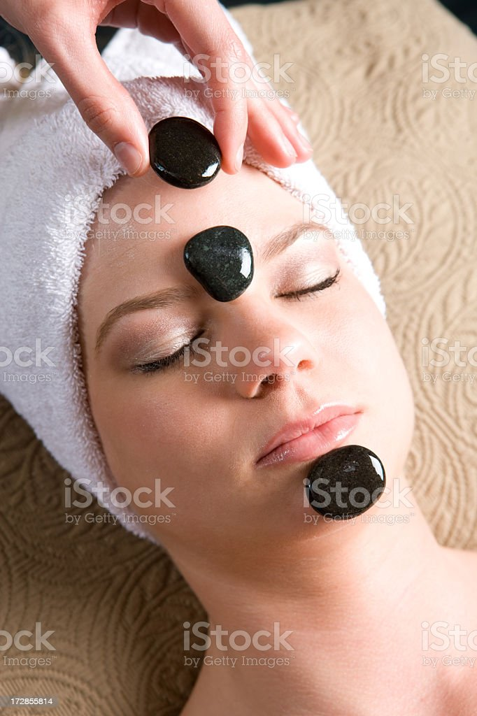 Medical Spa-Therapeudic Black Rocks Facial Treatment royalty-free stock photo
