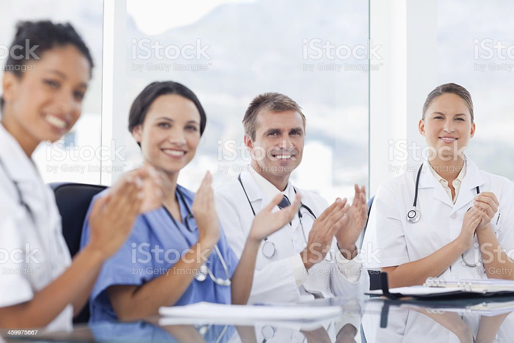 Medical staff clapping stock photo