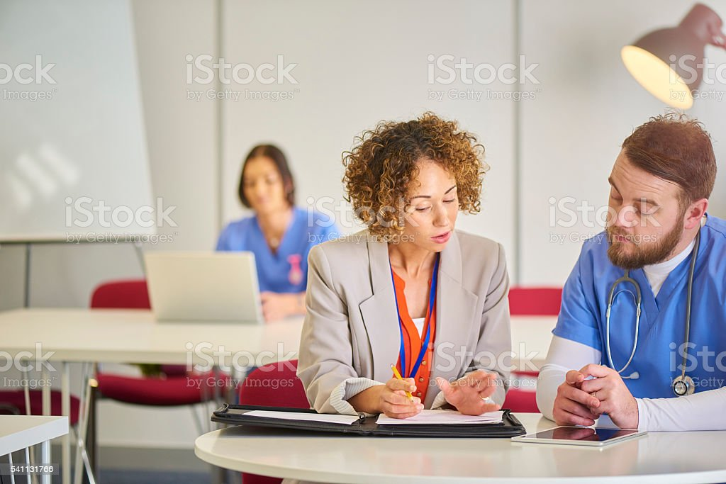 medical staff meeting stock photo