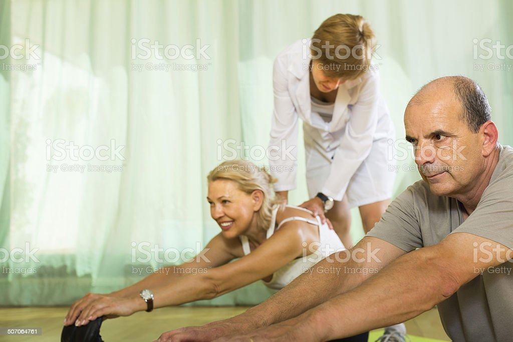 Medical staff with senior people at gym stock photo