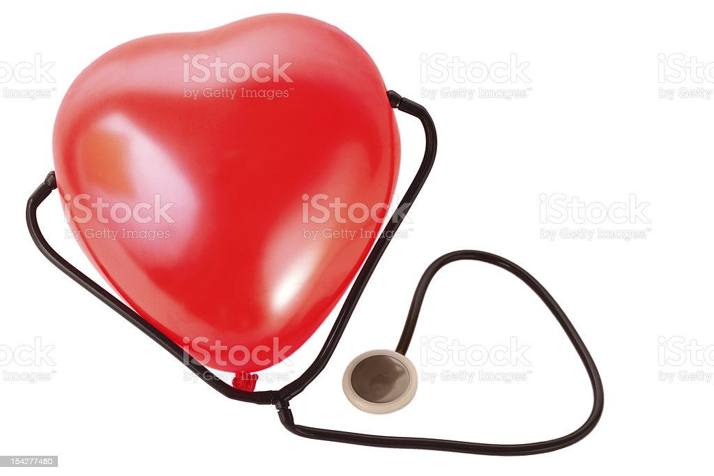 Medical stethoscope and red balloon heart isolated royalty-free stock photo