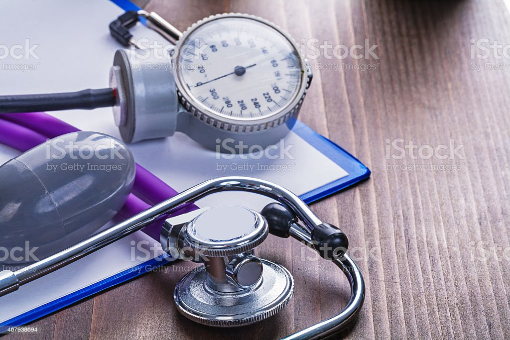 medical stethoscope blood pressure monitor on clipboard with bla stock photo