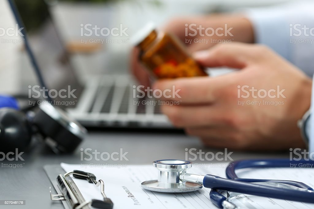 Medical stethoscope lying on clipboard pad closeup stock photo