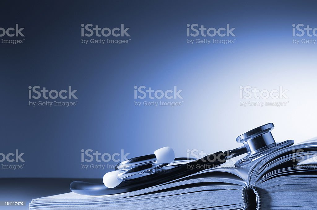 Medical stethoscope on open book with copy space stock photo