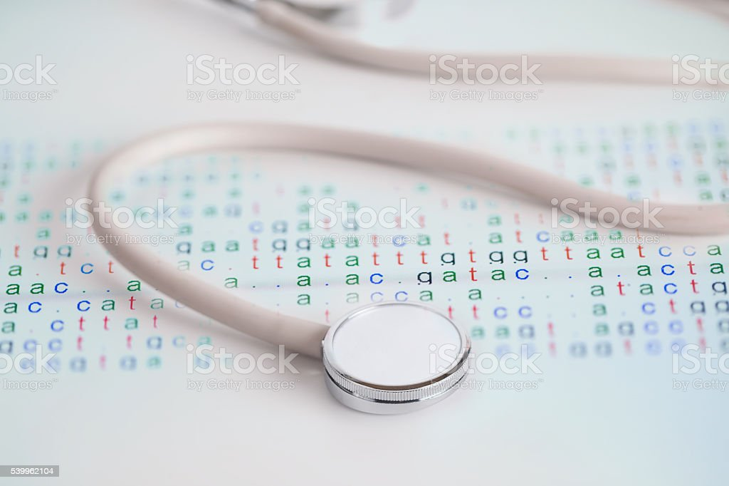 Medical stethoscope with color coded DNA stock photo
