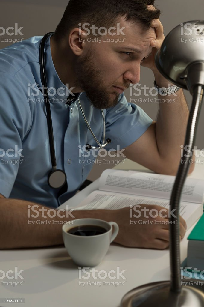 Medical student before exams stock photo