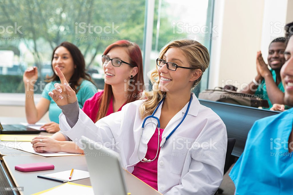 Medical students answering questions in class royalty-free stock photo