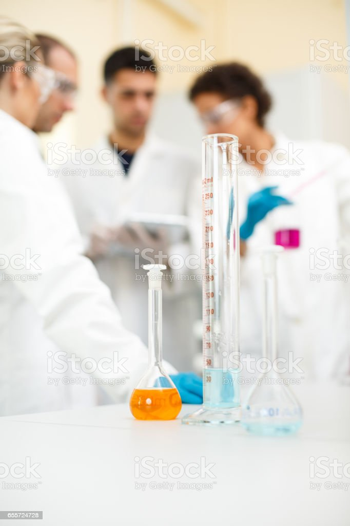 Medical students doing experiment in laboratory stock photo