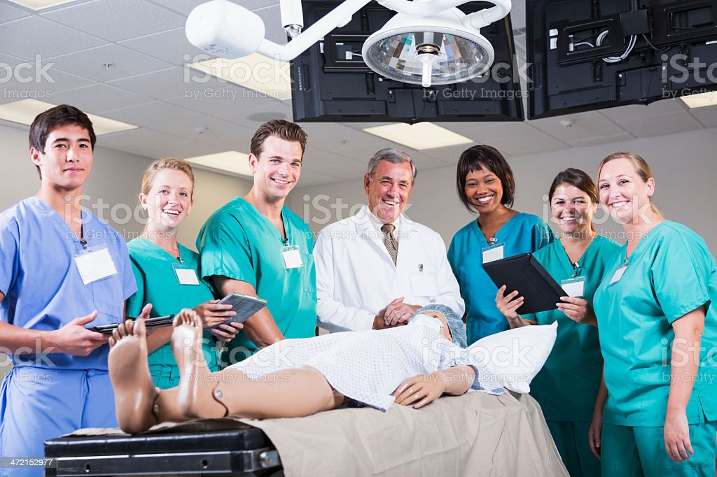 Medical students in operating room stock photo