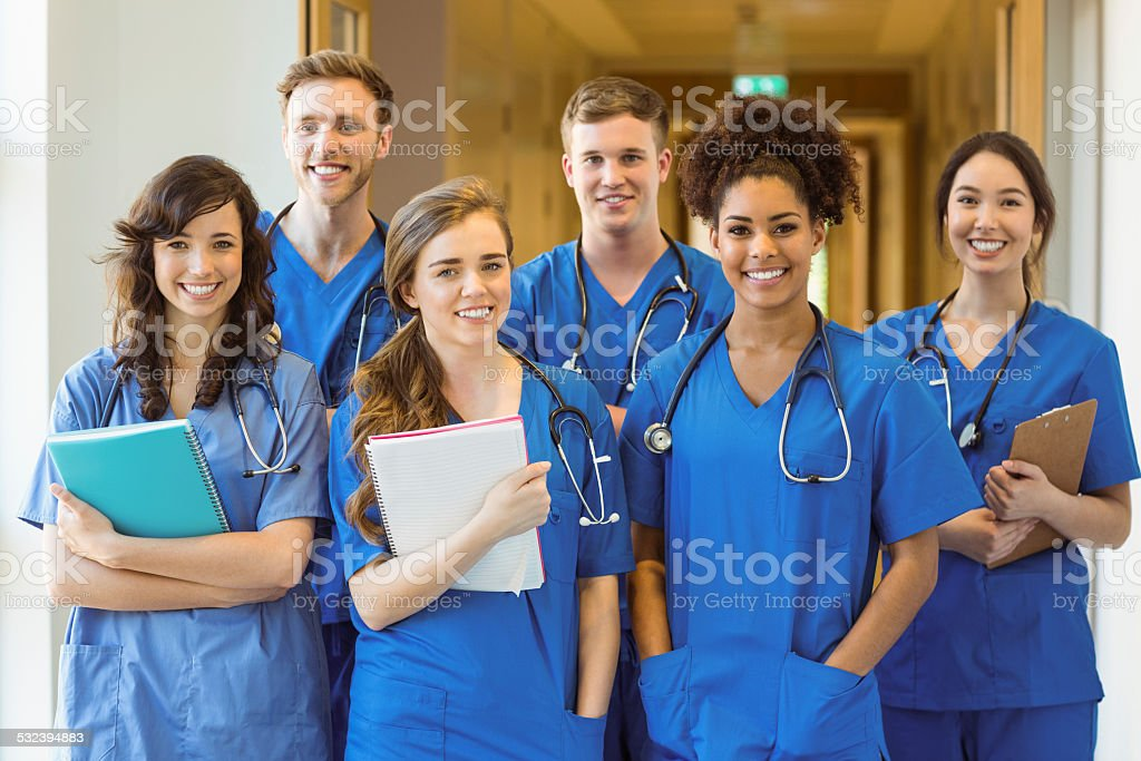 Medical students smiling at the camera stock photo